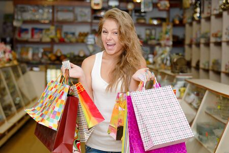 Happy young woman with shopping bags Stock Photo - 18161786