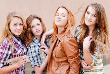 Four happy teenage girls friends photo