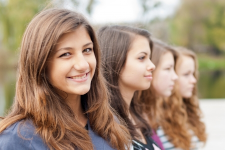 Four happy teenage girls friends photo