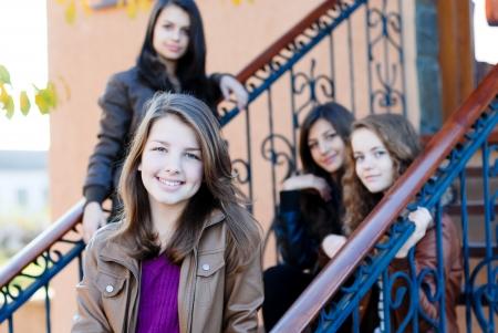 Four happy teen girls friends