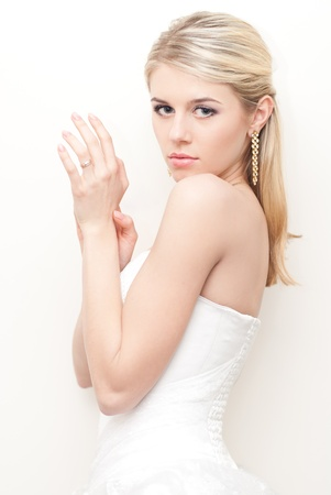 Beautiful young bride fashion studio shot photo