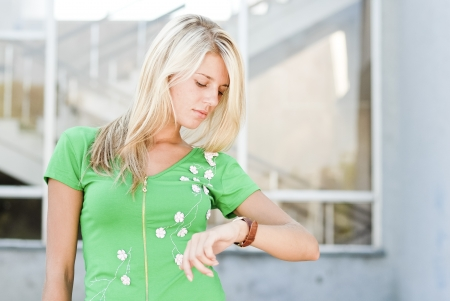 human wrist: Young woman looking on hand watch