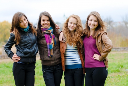 Four happy teenage girls friends Stockfoto