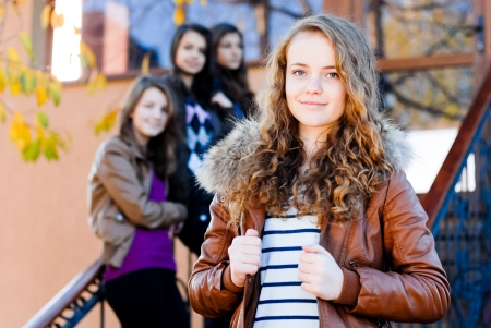 Four happy teen girls friends photo