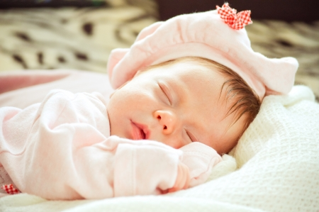 baby sleeping in pink newborn close up photo