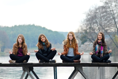 Young girls on the wooden bridge photo
