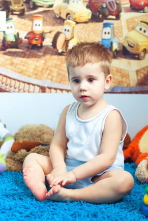 Happy kid  smiling boy on floor in living room at home Stock Photo - 18356353