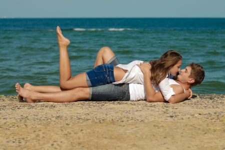 Young couple man   woman loving each other on sea