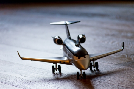 model airplane: Close-up of a toy airplane on the woodden floor