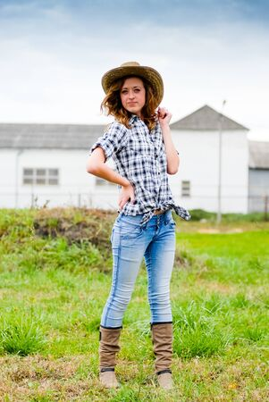 Pretty smiling happy teenage girl on sunny spring or autumn day in cowboy hat photo
