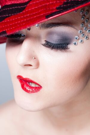 gracefully: elegant sensual girl with red hat