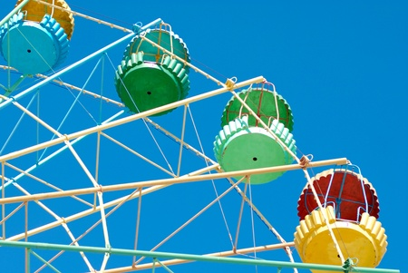 turnabout: Detail of a giant old carrousel ferris wheel on the blue sky background