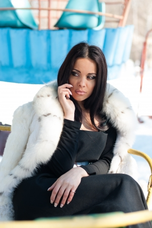 Winter Girl in Luxury Fashion Fur Coat on mobile phone Stock Photo - 18635525