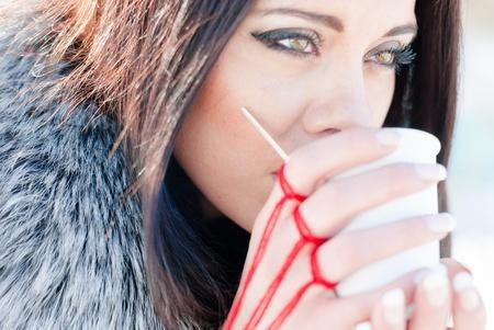 Beautiful girl holding cup of tea or coffee photo
