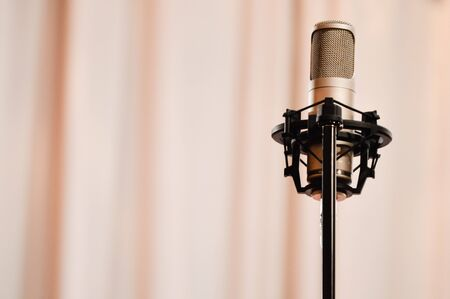 Microphone standing over the pink curtain photo