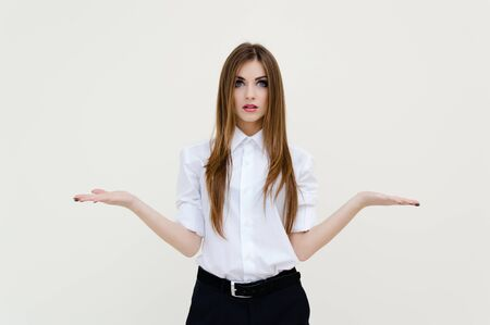 Beautiful young woman presenting something imaginary with her hands on white background photo