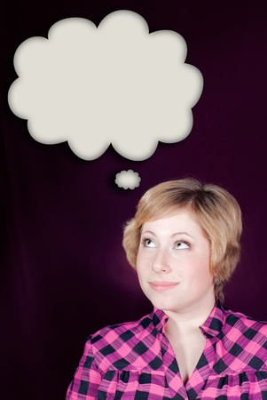 Thinking woman with many ideas in empty bubble on maroon background looking up photo