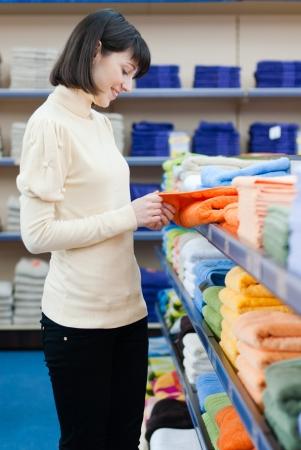 Beautiful young woman shopping towels photo