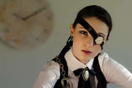 Ten past ten. Beautiful steampunk girl with a watch eye look on her face photo