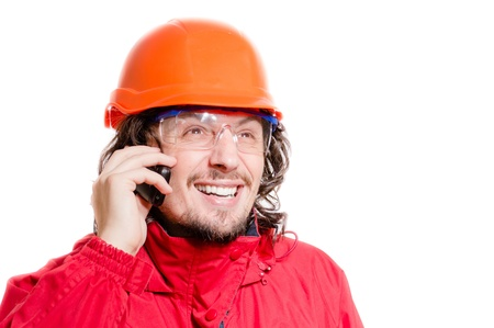 Man architect or builder in helmet speaking or screaming on mobile photo