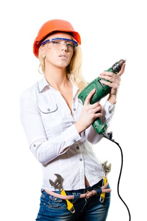 Young blond woman in constructor helmet holding drill isolted on white background copyspace photo