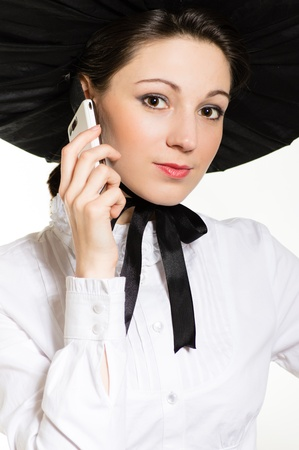Young happy smiling surprised woman in huge black hat with mobile phone looking closeup portrait Stock Photo - 19730730