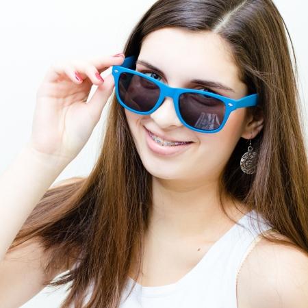 braces: Happy teenage girl wearing braces funny smiling isolated over white background