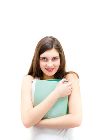 Teenage girl holding book and looking happy on white copyspace background Stock Photo - 20107899
