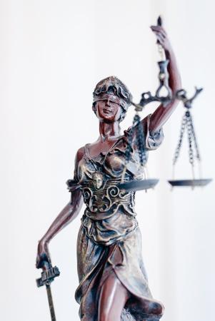 Femida bronze goddess statue holding scales