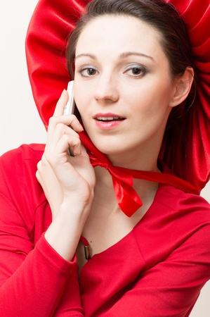 Red Hat calling, Young elegant happy woman wearing red dress & hat Stock Photo - 20554564
