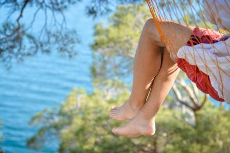 unworried: Man relaxing in a hammock on a beautiful sand beach  Cozumel, Mexico, Caribbean Sea  Stock Photo
