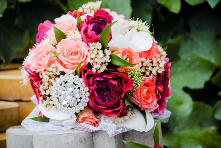 Wedding pink roses bouquet closeup outdoors alone