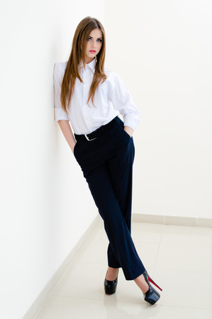 Fashion young business woman wearing man Imagens