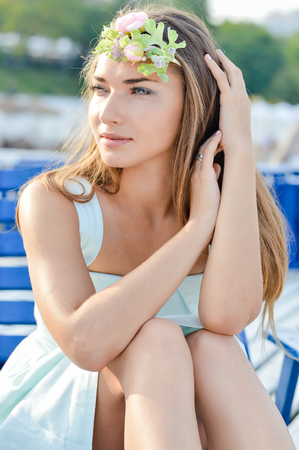 Portrait of pretty young woman enjoying sunny day on the sea beach lying on sun lounger Stock Photo - 23175829