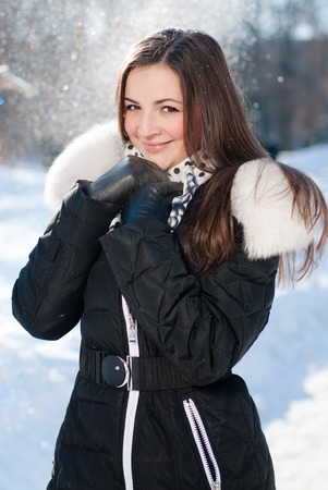 beautiful young happy smiling woman on the snow  photo