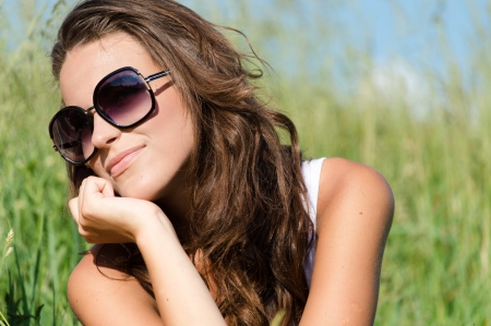 sun shades: Beautiful young woman wearing sun glasses on summer day outdoor portrait Stock Photo