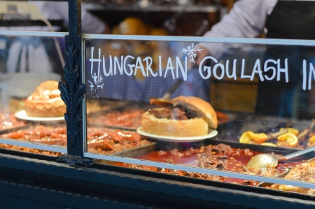 Goulash soup with beef, potato and meat sausage, served in a bread bowl on traditional Budapest food market