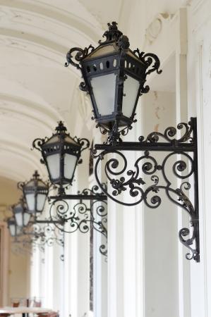 streetlamp: Row of beautiful retro vintage elegant street lamps hanging on wall