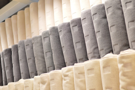 Row of new towels on shelf in department store photo