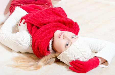 Beautiful happy smiling young woman wearing red knitted gloves and shawl photo