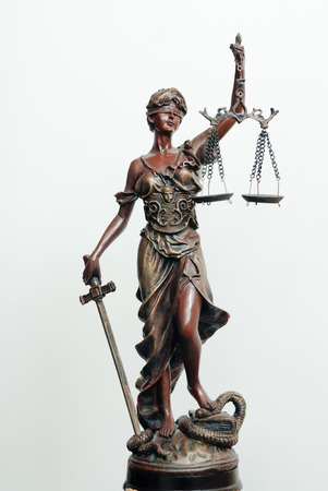 lady justice: themis, femida or justice goddess sculpture on white