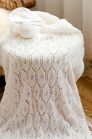 needle lace: Detail of woven handicraft knit woolen design texture and basket of clews  Fabric white background Stock Photo