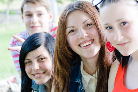 sociable: Young people teenage friends happy smiling   looking at camera on summer outdoors