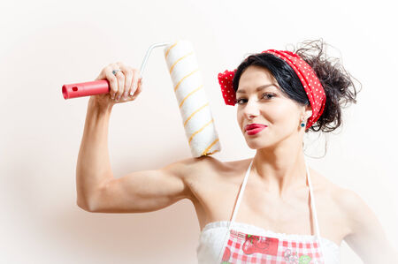 bolster: attractive young brunette pinup woman with blue eyes holding bolster happy smiling & looking at camera