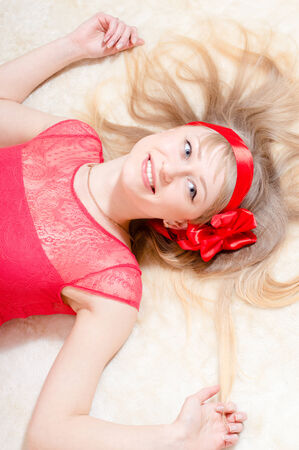 beautiful funny young blond woman pinup girl happy smiling   looking at camera on white background closeup portrait photo