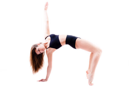 ductile: ductile flexible young woman makes athletic, gymnastic exercises isolated on white background portrait