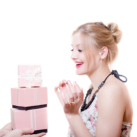 picture of receiving gifts or presents surprised attractive blond young woman elegant female having fun happy smiling isolated on white background portrait photo