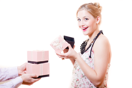 portrait of receiving gifts or presents gorgeous blond young woman blue eyes female having fun happy smiling   looking at camera on white background photo
