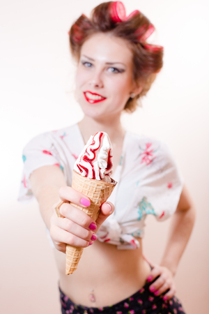 sexy funny pinup girl eating ice cream cone looking at camera happy smile isolated on white copy space background portrait image photo
