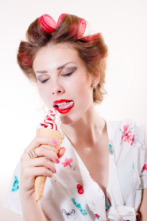 licking dessert: sexy beautiful pinup girl eating ice cream cone eyes closed isolated on white copy space background picture photo